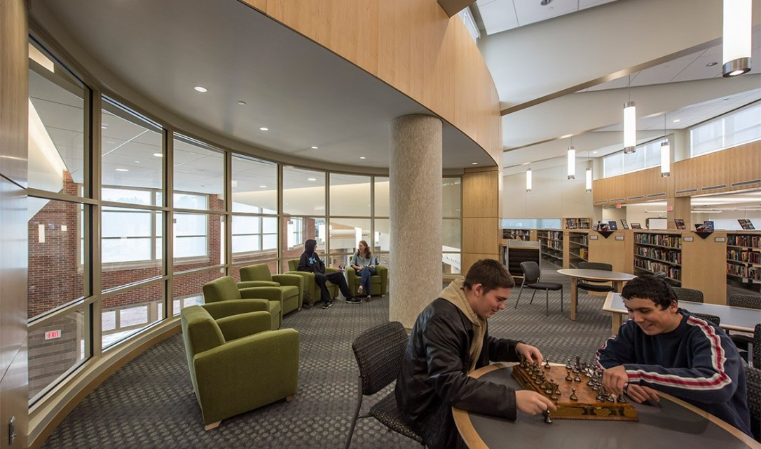 Students playing chess at Tewksbury High School library